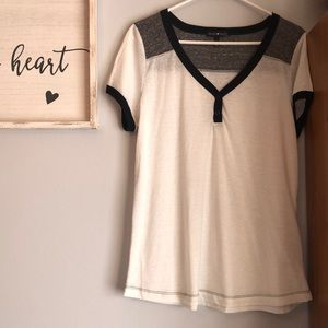 White shirt with gray and black accents